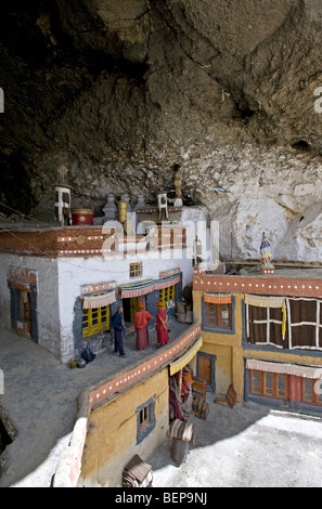 Buddhist monks entering into the sacred temple in the cave. Phuktal monastery. Zanskar. India - Stock Photo