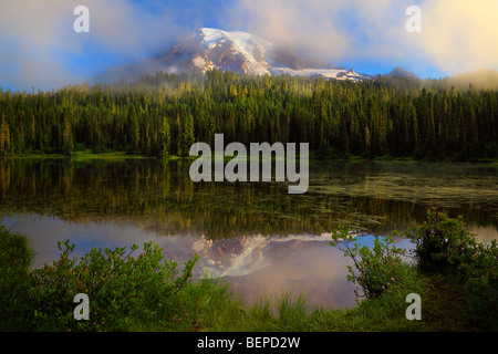 Misty Reflection at Mount Rainier's Reflection Lakes - Stock Photo