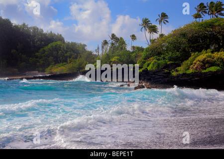Waves at Hana Bay on the northeast coast of Maui, Hawaii, in the town of Hana - Stock Photo
