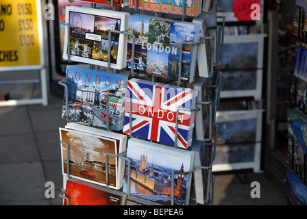 a rack full of postcards shows London - Stock Photo