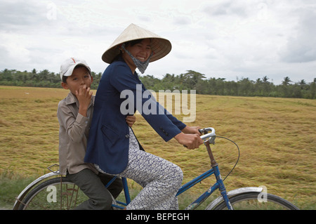 VIETNAM Scene in Vinh Long: mother and son on bicycle. photograph by Sean Sprague 2008 - Stock Photo