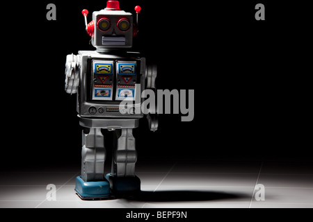 A vintage tin robot pictured in shadow - Stock Photo