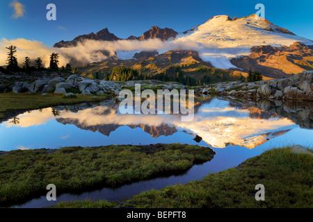 Mount Baker reflecting in tarn near Park Butte in the Mount Baker Wilderness - Stock Photo