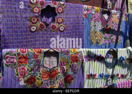 GUATEMALA  Market at Santiago de Atitlan, Detail of a huipil, or woman's blouse with intricate embroidery on hand - Stock Photo