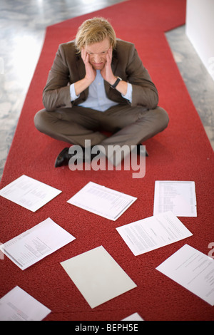 A Mid-40 Businessman is despaired - Stock Photo