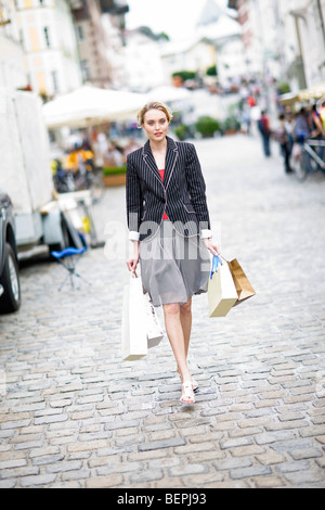 woman walks through a shopping street - Stock Photo