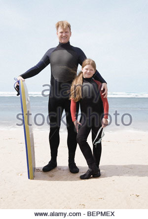 Man & girl wearing wet suits - Stock Photo