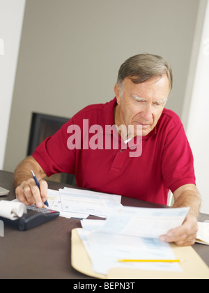 Senior man checking home finances. Copy space - Stock Photo