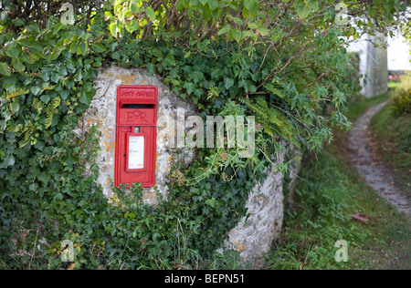 A rural post box on a wall in a country lane in Cornwall UK - Stock Photo