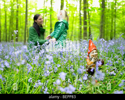 Garden gnome in the woods - Stock Photo