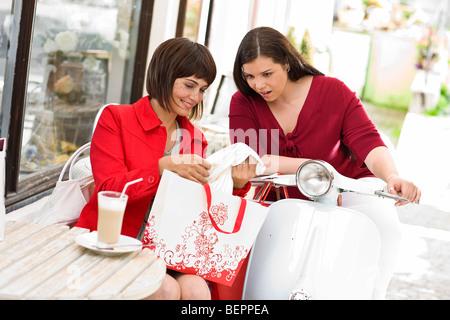 girlfriends meet in a street cafe - Stock Photo