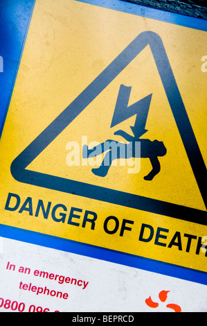 Electricity Warning Sign 'Danger of Death' - Stock Photo