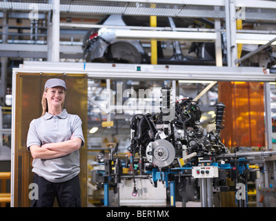 Female Car Worker With Car Parts - Stock Photo