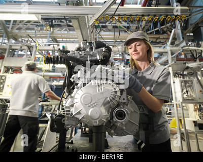 Car Workers Building Car Parts - Stock Photo