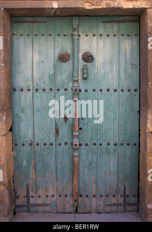 old closed dusty abandoned wooden door in nicosia lefkosia republic of cyprus - Stock Photo
