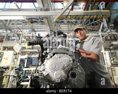 Car Worker Building Car Parts - Stock Photo