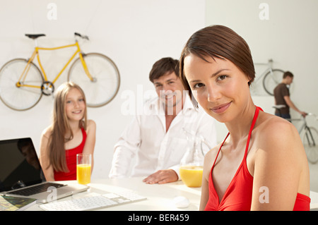 proud woman selling bicycles - Stock Photo