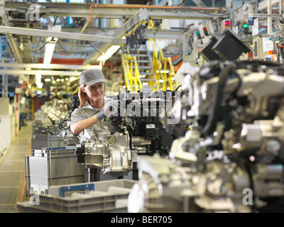 Female Car Worker And Car Parts - Stock Photo