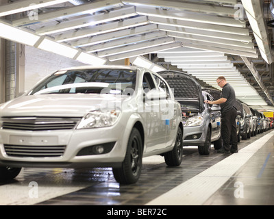 Worker Checking Cars On Production Line - Stock Photo
