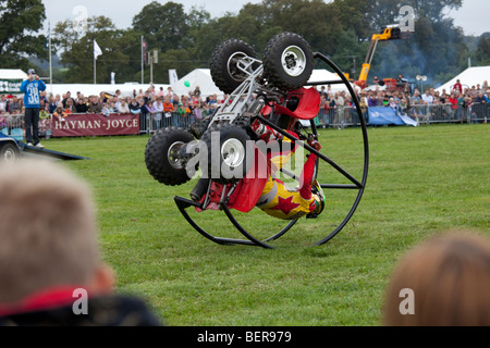 Kangaroo Kid alias Matt Coulter somersaulting on quad stunt bike Moreton Show September 2009 UK - Stock Photo