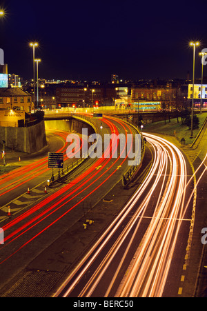 traffic light trails of vehicles heading too and from the city of leeds at night yorkshire uk Stock Photo
