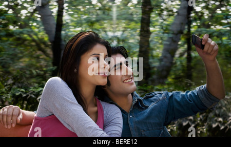 Couple taking their own picture - Stock Photo