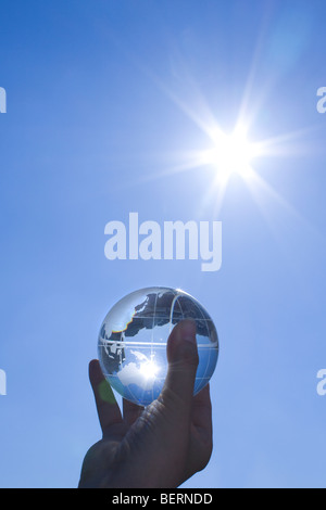 Man holding glass globe - Stock Photo