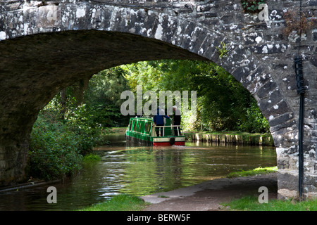 Canal boat saling on the Monmouth and Brecon Canal taken at Llangynidr mid Wales on fine day - Stock Photo