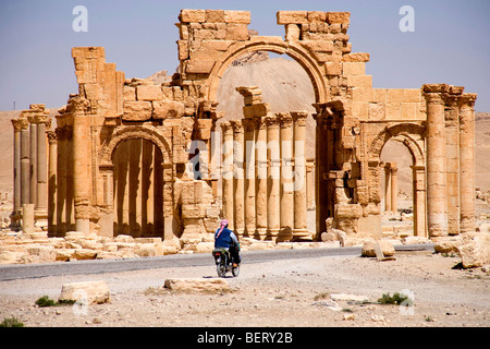 Motorcycle near roman ruins and archaeological site in Palmyra, Syria, Middle East, Asia - Stock Photo