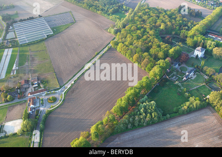 Castle, urbanisation at the border of agricultural area from the air, Belgium - Stock Photo