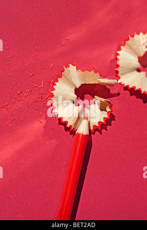 Red pencil and pencil shavings - Stock Photo