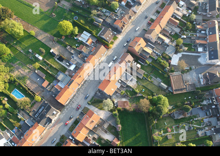 Ribbon development, urbanisation at the border of agricultural area from the air, Belgium - Stock Photo