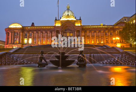 A long shutter exposure captures the subtle tones of the artificially lit water feature named 'The River' in Birmingham - Stock Photo