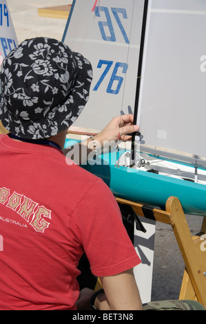 A man works in a radio control model scale ship during a competition - Stock Photo