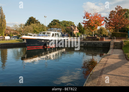 Pleasure cruiser emerging from Hambleden Lock near Henley, River Thames, Oxfordshire, Uk - Stock Photo