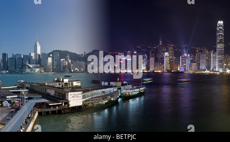 A blended image of Hong Kong harbour and the Star Ferry terminal, showing the day and night aspects of this vibrant - Stock Photo
