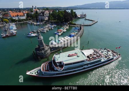 Excursion boat entering harbor, Lindau, Bayern, Germany - Stock Photo