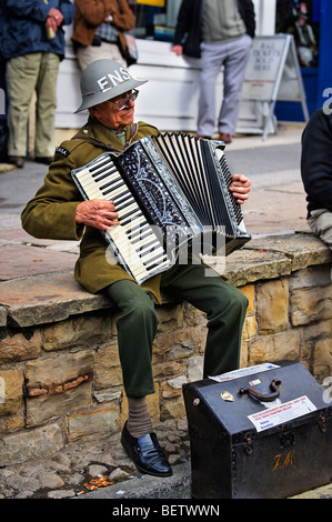 Accordian player wearing WWII ENSA uniform enteraining the crowds at the Pickering Wartime Weekend October 2009 - Stock Photo