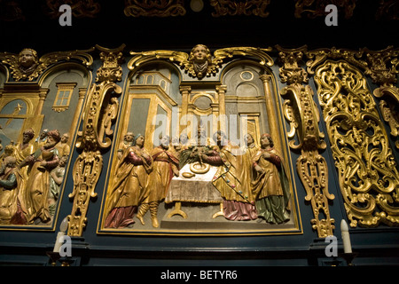 Religious imagery / wood carving / panels in the nave of St Marys Basilica, Krakow. Poland. - Stock Photo