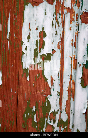 flaking painted wooden door with numerous layers of old paint - Stock Photo