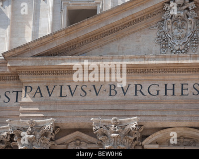 A detail of latin inscription on the front of St Peter's Basilica, Vatican City, Rome, Italy - Stock Photo