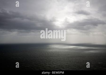 Rain clouds over sea - Stock Photo