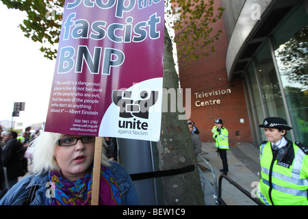 Protester and police at the BBC against the BNP leader Nick Griffin's appearance on Question Time - Stock Photo