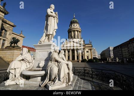 Berlin. Germany. Gendarmenmarkt. Statue of Friedrich Schiller and the French Cathedral Französischer Dom. - Stock Photo