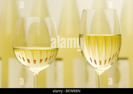 Two filled white wine glasses, upper section - Stock Photo