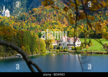 View over a lake, Neuschwanstein Castle in the background, Bavaria, Germany - Stock Photo