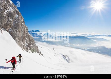 two men ski touring in the mountains, Salzburg, Austria, high angle view - Stock Photo