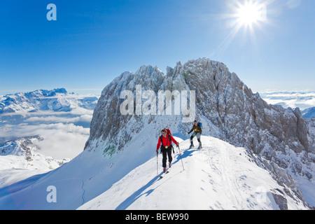 two men ski touring in the mountains, Salzburg, Austria - Stock Photo