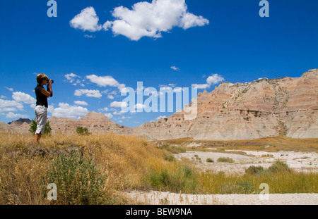 Woman taking pictures with her camera, South Dakota, USA - Stock Photo