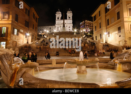 The Fountain of the Old Boat (Fontana della Barcaccia) in front of the Spanish Steps at night, Rome, Italy - Stock Photo